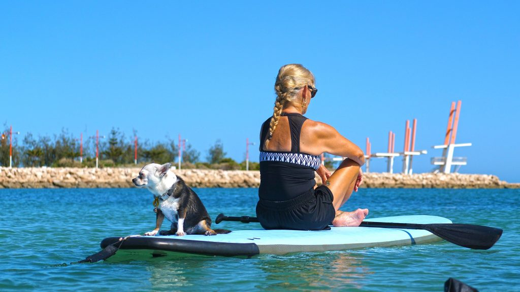 Lady and dog at SUP Yoga Class